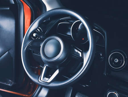 The steering wheel in the car driver cockpit of modern car