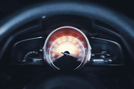 Car speedometer high performance and indicator sweeping to max power speed,dashboard car motion,double exposure automotive concept