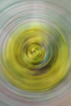 spin: Yellow abstract background of spin circle radial motion blur