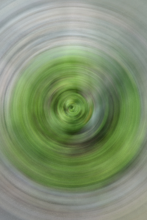 spin: Green abstract background of spin circle radial motion blur