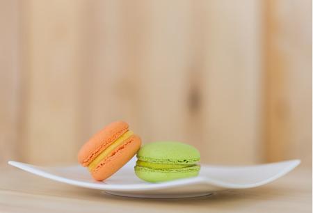 tasty: Tasty Sweet Macaroons on wooden background.