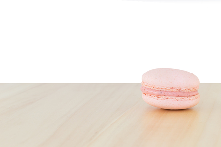 macaroon: Pink Macaroon on wood  with white background