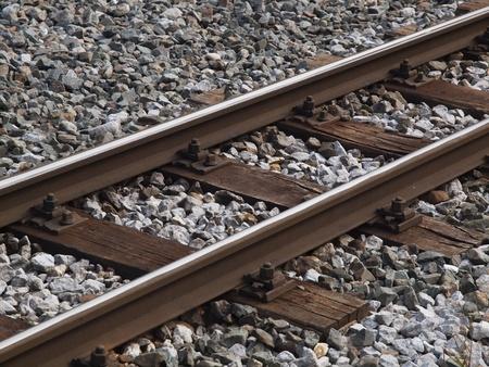 sleepers: Rails with wooden sleepers Stock Photo