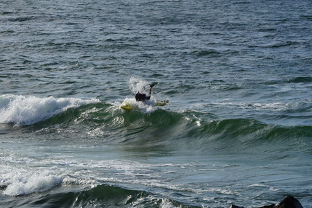 Paddler in the waves of the Baltic Sea Stock Photo