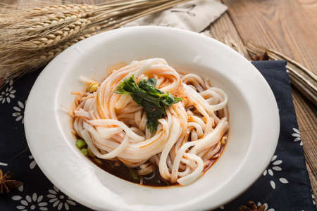 Chinese style noodle served in a bowl Stock Photo