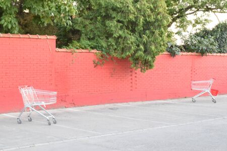 shoping: Red wall and a two shoping carts