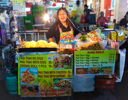 BANGKOK THAILAND- JAN 16  An unidentified Padthai seller standing on Khaosan Road Bangkok, Thailand on 16 January 2014  Padthai is one of the most famous food for foreigner in thailand