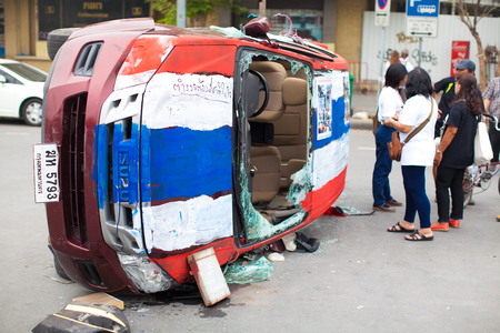 collide: Bangkok , Thailand - Feb 20 ,2014   Car of police after collide with Anti-government protester on   Ratchadamnoen Road Bangkok Thailand  Police and Anti-government protester collided near Democracy   monument on Ratchadamnoen Road 18 February 2014   Editorial