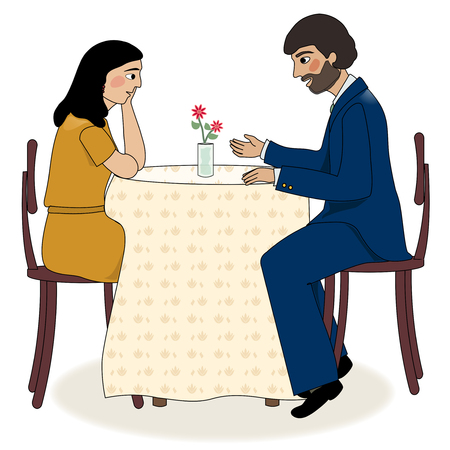 A man and woman sitting at a table talking