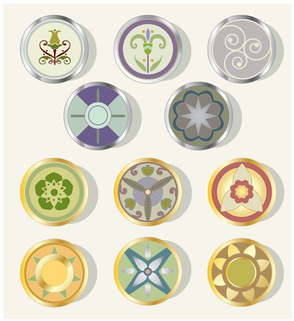 Eleven round design elements of various types, with metallic bevels