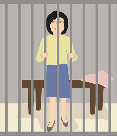 woman prison: A woman stands in prison, holding the bars