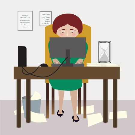 employers: A woman sits at her desk, working at her job