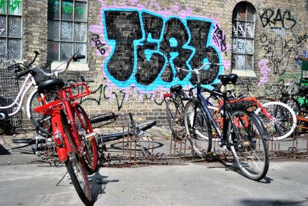 Two bikes and urban graffiti in Copenhagen, Christiania Editorial