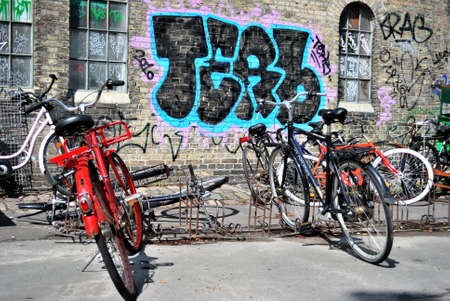 Two bikes and urban graffiti in Copenhagen, Christiania Stock Photo - 13761077
