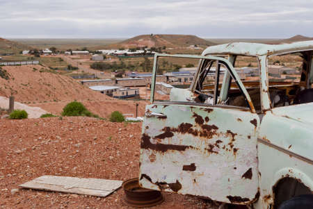 Abandoned rusty car in Coober Pedy, South Australia photo