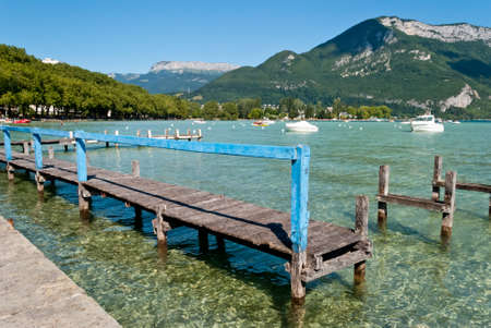 savoy: Wooden quay in Annecy lake, Savoy, France Stock Photo