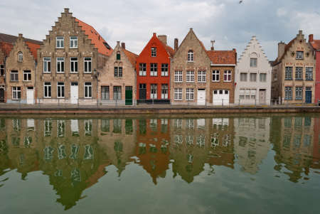 along: Bruges, Belgium, houses along the channel