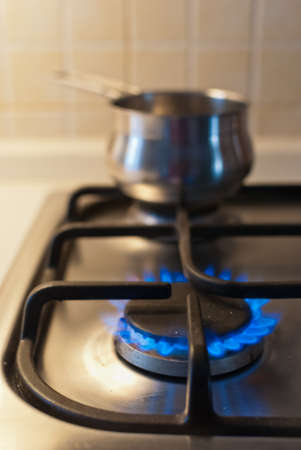 Gas cooker with methane flame Stock Photo