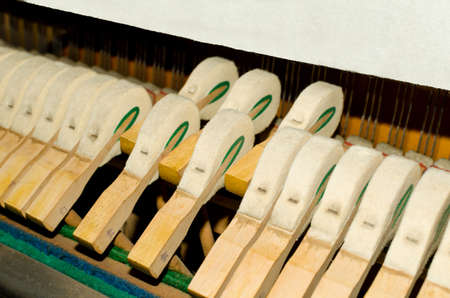 Upright piano hammers detail photo