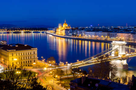 Budapest, night view on Danube, Parliament and Chain Bridge photo