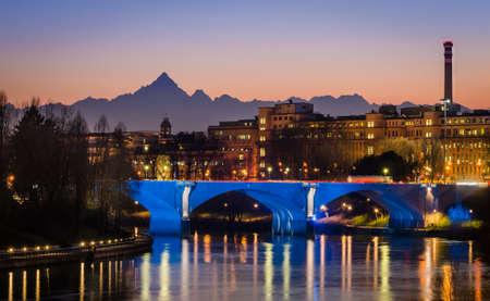 Turin (Torino), river Po and Monviso at sunset photo