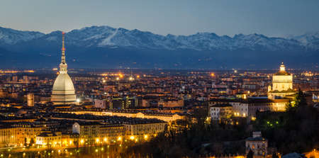 Turin (Torino), night panorama with Mole Antonelliana and Alps