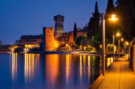 Lake Garda, Town of Sirmione (Lombardy, Italy) at blue hour Stock Photo