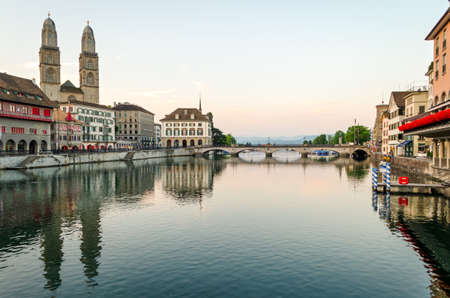 grossmunster cathedral: Zurich, old town and Limmat river at sunrise, Switzerland Stock Photo