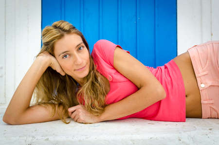 bellybutton: Beautiful Italian girl in pink t-shirt laying down Stock Photo