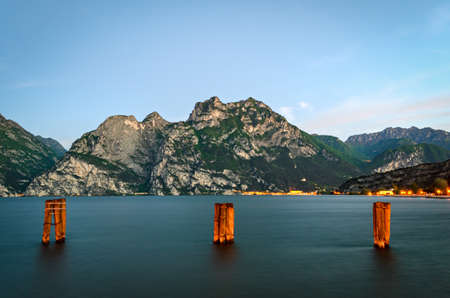 morning blue hour: Beautiful landscape with lake and mountains (Lago di Garda Italy) Stock Photo