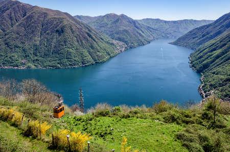 Lago di Como (Lake Como) scenic view with cable car between Argegno and Pigra