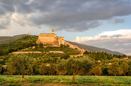 of assisi: Assisi (Umbria) Basilica di San Francesco at sunset Stock Photo