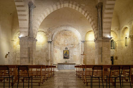 church interior: Old medieval romanic church interior with soft light Editorial