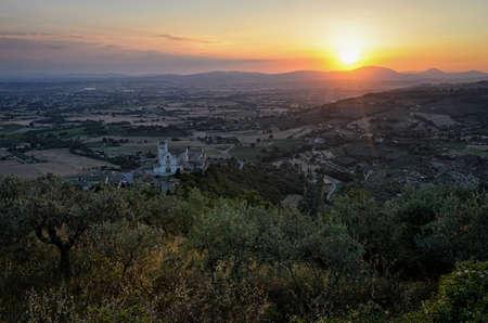 assisi: Assisi (Umbria) scenic panorama with Basilica di San Francesco at sunset