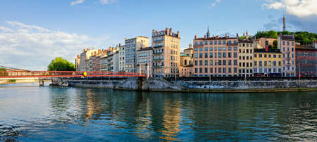 Lyon old buildings along river Saone at sunset Stock Photo