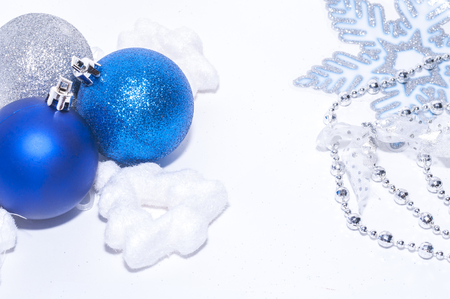 Blue and silver xmas decoration with copy space on white background photo