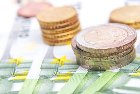 opulence: close-up shots in macro lens money euro coins and banknotes Stock Photo