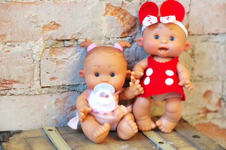 cute doll on a light textile clothing natural
