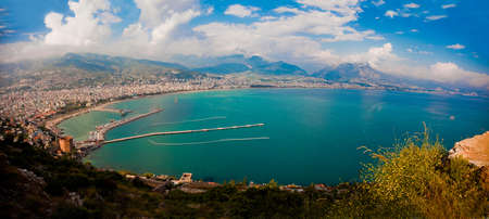Alanya city harbor panorama in the evening