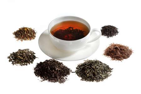 gunpowder tea: Tea assortment around the white cup of tea