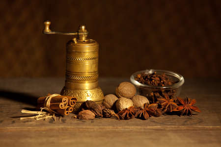 brassy: Still life with different spice and brassy quern