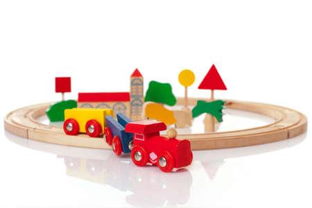 Tren de juguete de madera sobre el fondo blanco Foto de archivo - 8532901