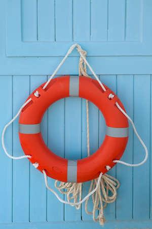 Life saver hanging on the wall Stock Photo