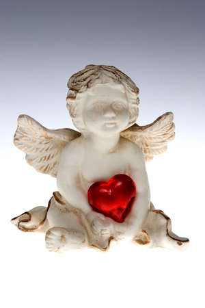Cupid with red heart photo