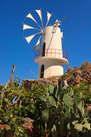 decades: Irrigation windmills are the symbol of the Lasithi Plateau, Crete, Greece. White-sailed windmills have been used for decades to irrigate the land.