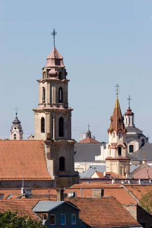 oldtown: Rooftops of churches in Vilnius old-town, Lithuania. Stock Photo