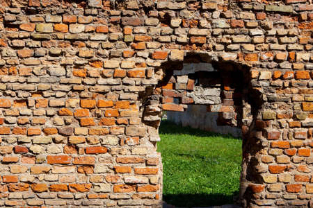 embrasure: Old red brick wall with embrasure Stock Photo
