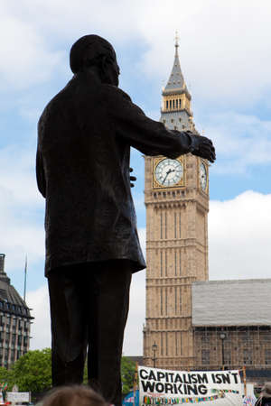 nelson mandela: Silhouette of Nelson Mandela statue at Parliament Square, with Big Ben in the Clock Tower and banner of strikers in London, Great Britain Editorial