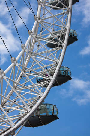 millennium wheel: London, United Kingdom - June 11, 2010: London Eye, or Millennium Wheel, is a giant 135-metre (443 ft) tall Ferris wheel situated on the banks of the River Thames.