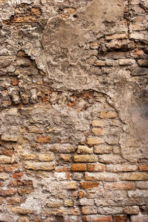 crumbled: Old crumbled clay brick wall
